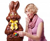 Blond Girl Stealing Easter Eggs Of A Chocolate Bunny