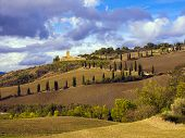 foto of plowed field  - Tuscan hilly countryside with plowed fields in the foreground in autumn - JPG