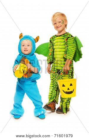 Two brothers in monster costumes on Halloween