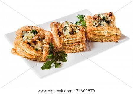 three tasty tartlets on white plate