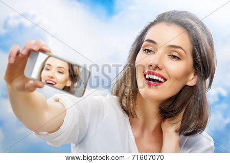 a beauty girl taking selfie