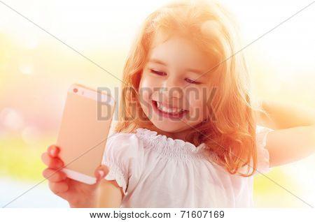 a beauty child taking selfie