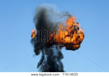 Large industrial fire with thick black smoke