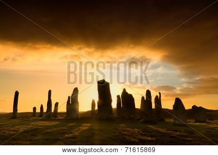 Megalithic stone circle of 3000 bc on the Isle of Lewis and Harris, Outer Hebrides, Scotland, silhouette at sunset