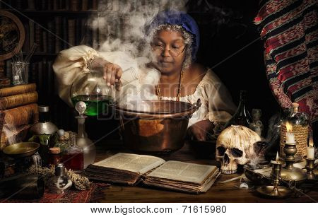Female alchemist preparing green liquids in a smoking kettle