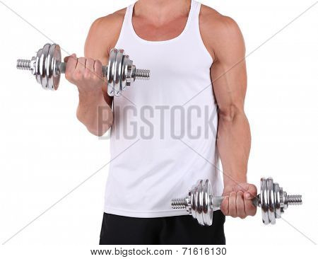 Young muscular sportsman execute exercise with dumbbells isolated on white