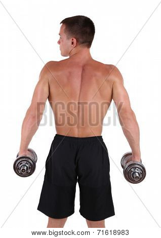 Handsome young muscular sportsman execute exercise with dumbbells isolated on white