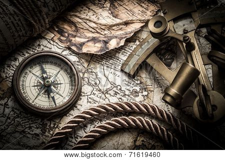 vintage  still life with compass,sextant and old map.map used for background is in Public domain. Map source: Library of Congress. Country: Belgium Year: 1570. Author: Abraham Ortelius (1527-1598)
