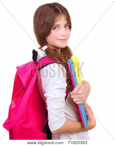 Side view of cute brunette schoolgirl with big pink schoolbag and holding in hands colorful textbooks, isolated on white background, back to school concept