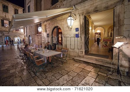 DUBROVNIK, CROATIA - MAY 27, 2014: People sitting at the table at restaurant Proto's  terrace. Dubrovnik has many restaurants which offer traditional Dalmatian cuisine and some great wine lists.