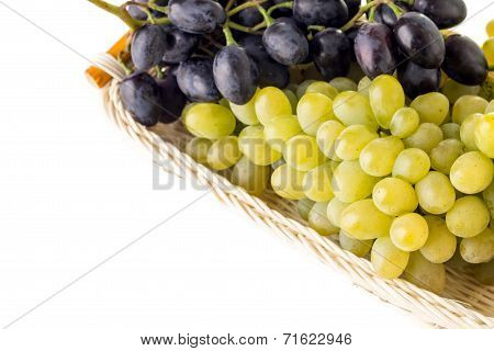 Different Grapes Varieties In Wicker Basket Isolated On Whire Background