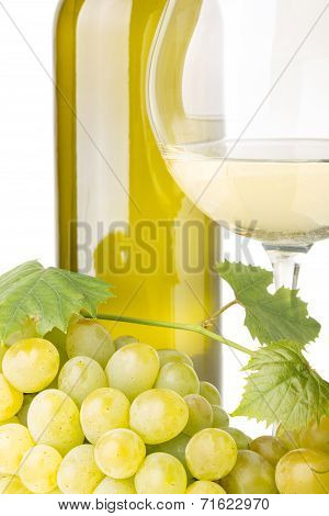 Cluster Of White Grapes With Grapevine, Glass Of Wine And Bottle On White Background