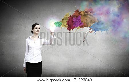 Young pretty woman in shirt and colorful splashes