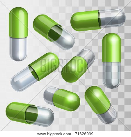 Set of green and transparent medical capsules in different positions