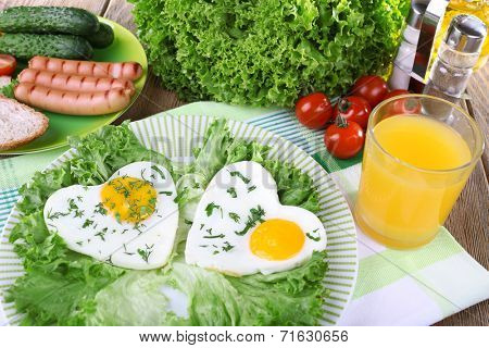 Scrambled eggs with sausage and vegetables served on plate on napkin