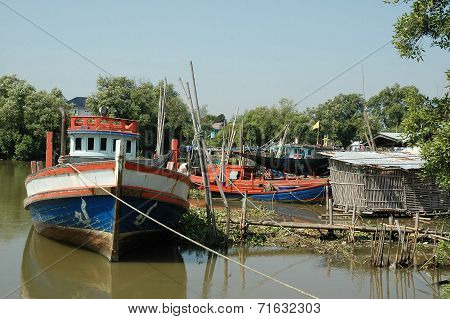 Fishing Boat Lays alongside the Dockage