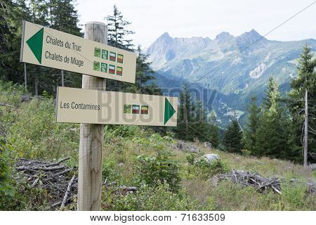 LES CONTAMINES, FRANCE - AUGUST 25: Mont Blanc tour direction signs. The tour goes through France, Italy and Switzerland, and is clearly signalised throughout. August 25, 2014 in Les Contamines.