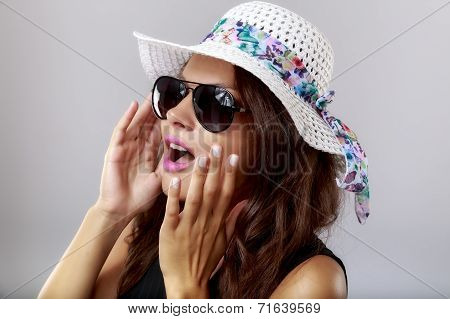 Happy Woman With white Hat and sun glasses