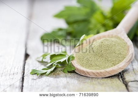 Lovage Powder On A Wooden Spoon