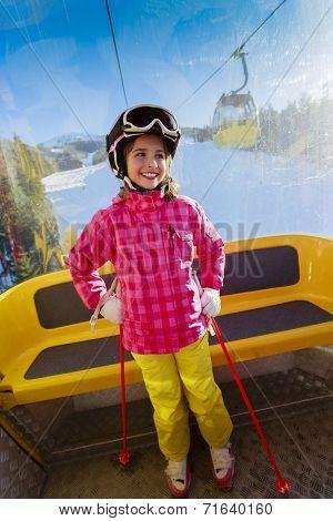 Ski, ski cable car, skier - happy girl in cable car
