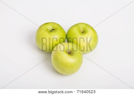 Three Granny Smith Apples On White Counter