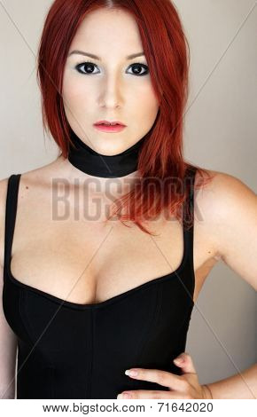 Sexy Redhead Girl In Black Corset With Black Ribbon On The Neck Portrait