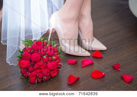 Female Feet In White Wedding Sandals With A Bouquet