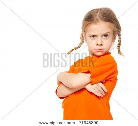 Little girl at yellow jeans. Child on white background