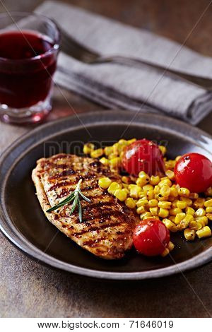 Grilled turkey fillet with sweetcorn and tomato