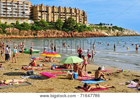 SALOU, SPAIN - AUGUST 29:  Vacationers in Capellans beach on August 29, 2014 in Salou, Spain. Salou is a major destination for sun and beach for European tourism with more than 50,000 accommodations