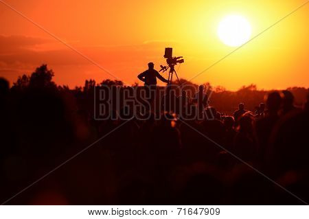 Silhouette of a TV cameraman