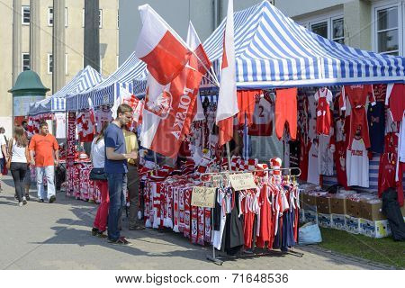 WROCLAW, POLAND - SEPTEMBER 6: Polish fans accessories stand in front of the sports hall during the European Championship in volleyball on 6 September 2014 in Wroclaw, Poland.