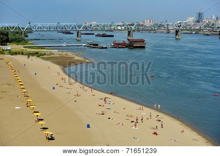 NOVOSIBIRSK, RUSSIA - AUGUST 24, 2014: People resting on the beach Nautilus on the left bank of Ob river. It's the main city beach of Siberia's capital