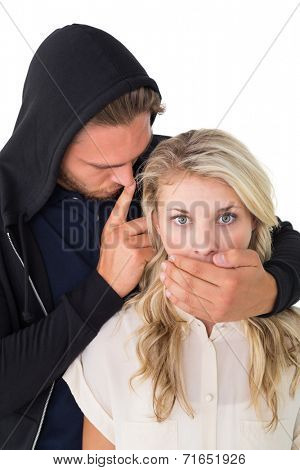 Close up of theft covering young woman's mouth over white background