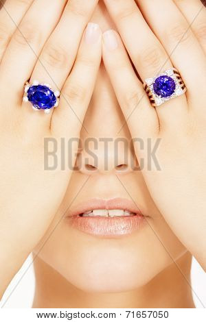 Closeup of a Model Wearing two Tanzanite Designer Rings, Isolated on White