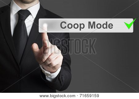 Businessman Pushing Button Coop Mode Green Checked