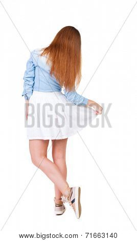 back view of standing young beautiful  woman makes a curtsey. Rear view people collection.  backside view of person.  Isolated over white background.