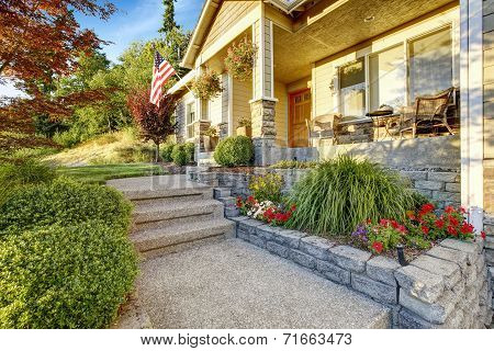 Romantic Sitting Area On Entrance Porch. Walkway With Flower Bed