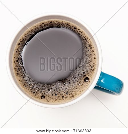 Top view of a coffee cup with gentle foam
