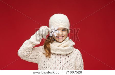 winter, people, happiness concept - girl in hat, muffler and gloves with big snowflake