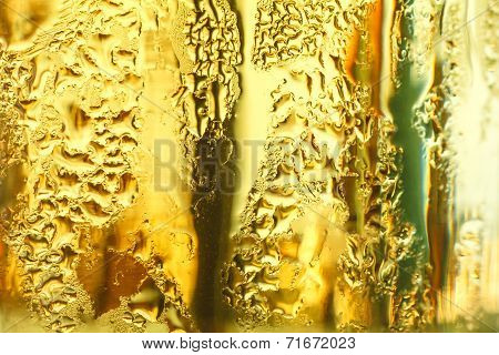 misted glass of cold drink close up.