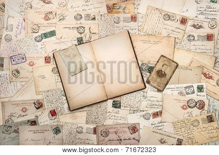 Old Handwritten Postcards And Open Empty Book
