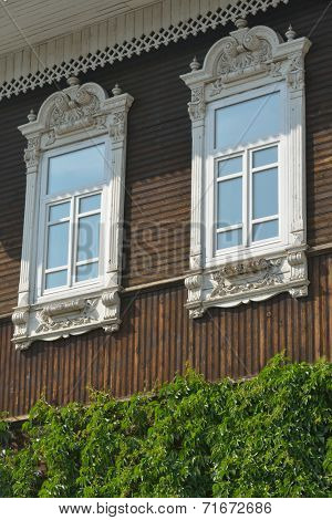 Decorated windows of the old mansion in Novosibirsk, Russia