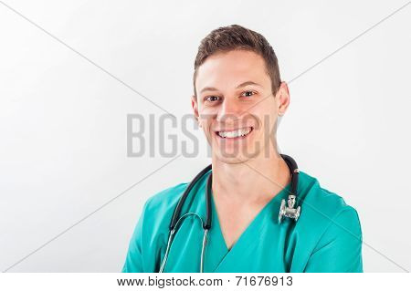 Medical portrait. Male nurse or young man doctor smiling