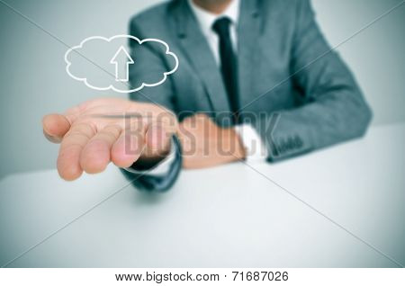 a man with a drawing of a cloud with an arrow inside, depicting the concept of upload to the cloud storage