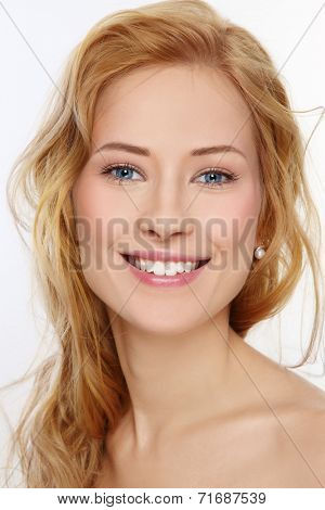 Portrait of young beautiful happy smiling girl with curly hair and clean make-up