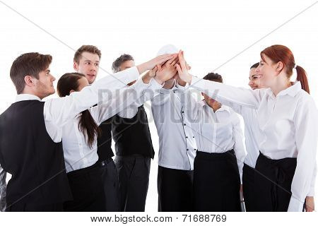 Catering Staff Making High Five Gesture