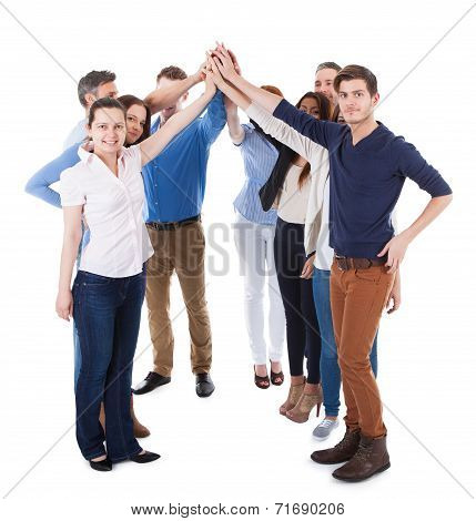 Diverse Group Of People Making High Five Gesture