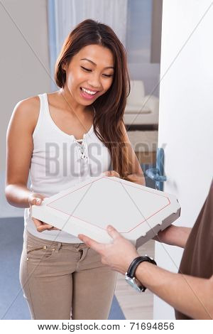 Woman Receiving Pizza From Delivery Man