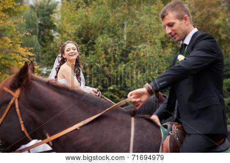 Wedding Couple On Horses